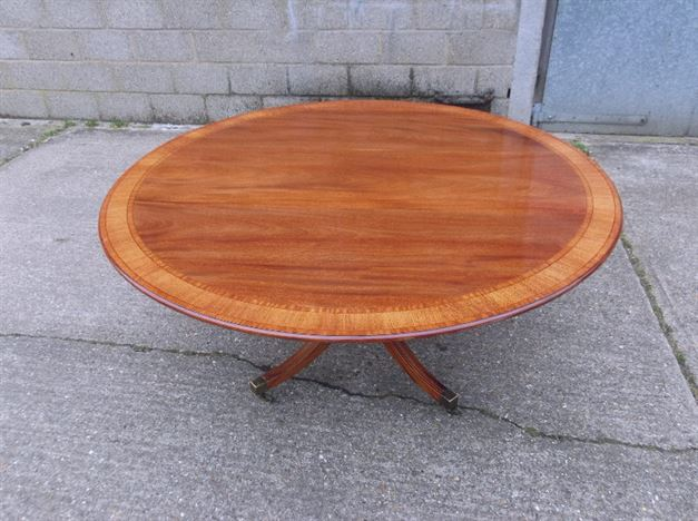 revival round mahogany and crossbanded dining table to seat 8 people