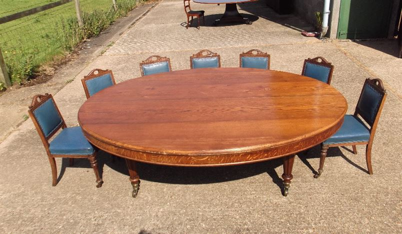 Large Oval Antique Dining Table - Mid Victorian Oval Formed Oak Table By Howard & Sons To Seat 12 People