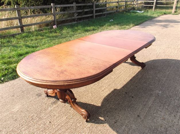 Victorian Mahogany Round End Table - Late 19th Century Mahogany Oval Formed Pedestal Based Extending Table With Leaf Keep